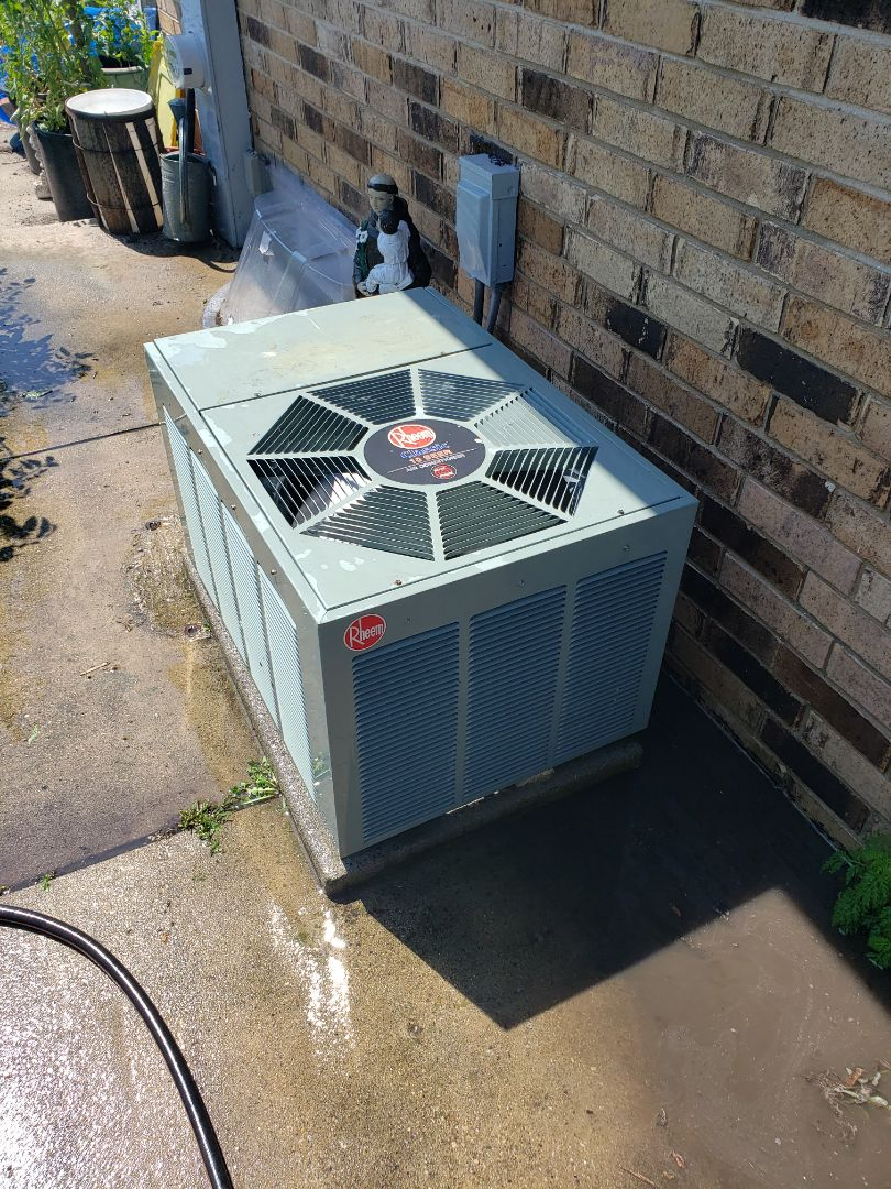 Kenosha, WI - Breathing some life back into an old Rheem RAKA series condenser. Questioning whether your existing AC has much time left? Have us come out and check it out! Don't hesitate to call!