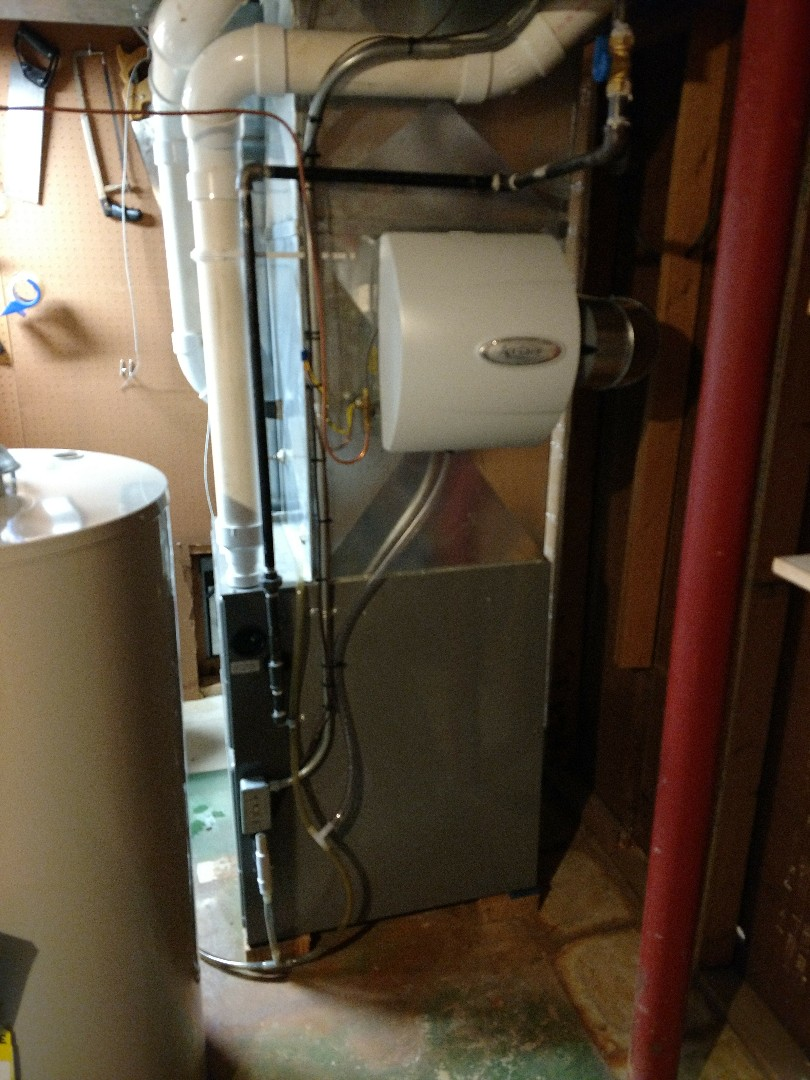 Kenosha, WI - Performed humidifier installation and tune up on Rheem high efficiency furnace