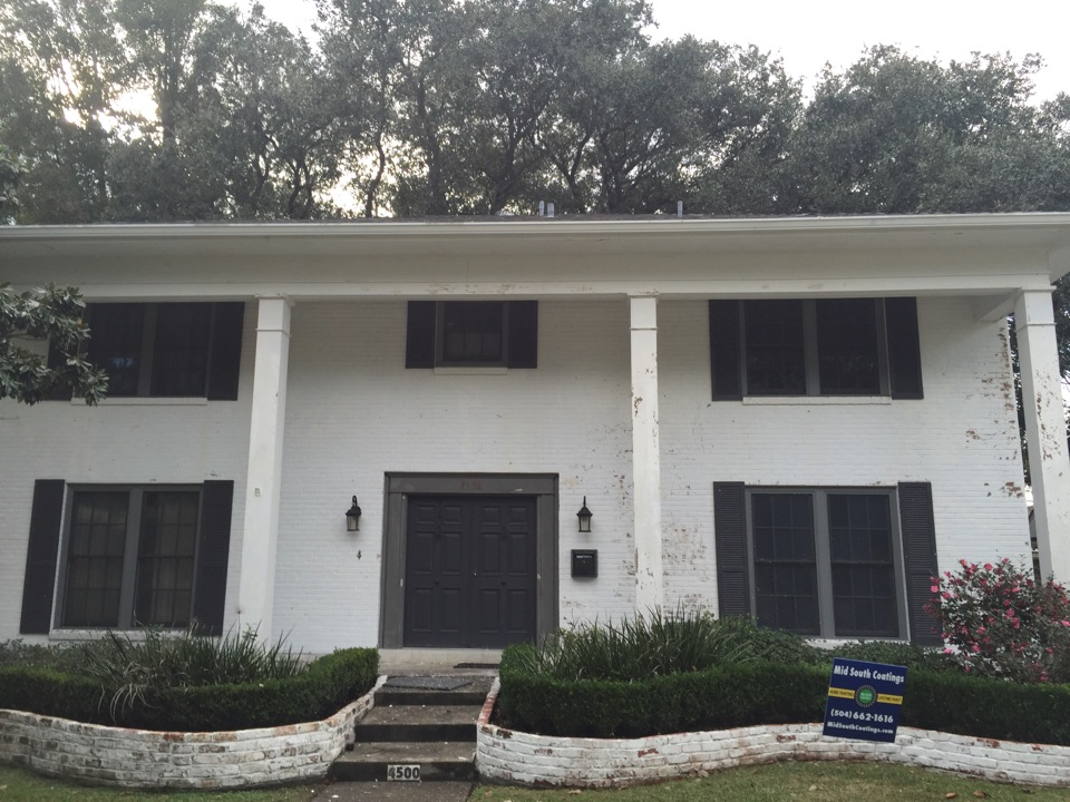 Metairie, LA - Just starting a painting and coating job, pressure washing to remove loose and flaking paint