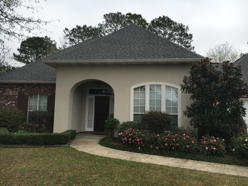 Mandeville, LA - Painting and coating exterior of home with cool wall system