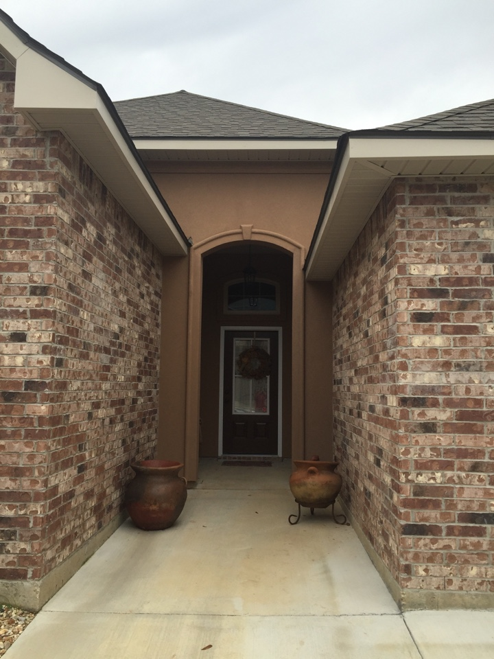 Baton Rouge, LA - Coating over stucco on the front of a home