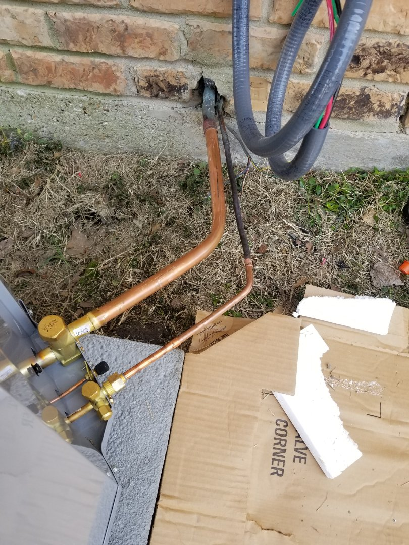 Terrell, TX - Piping in copper lines to carrier heat pump