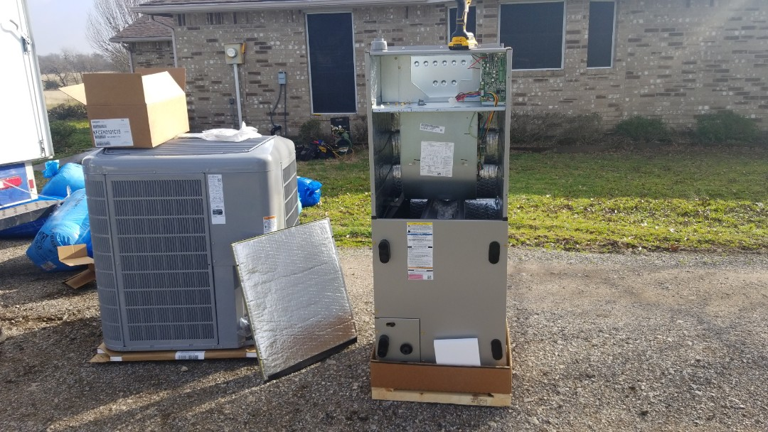 Campbell, TX - Installing carrier heat pump system with all new duct work