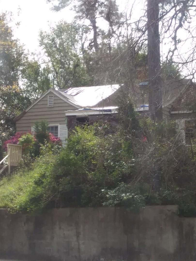 Hurricane roof damage, replace asphalt shingles and entry door with hurricane rated shingles and lifetime steel entry door.