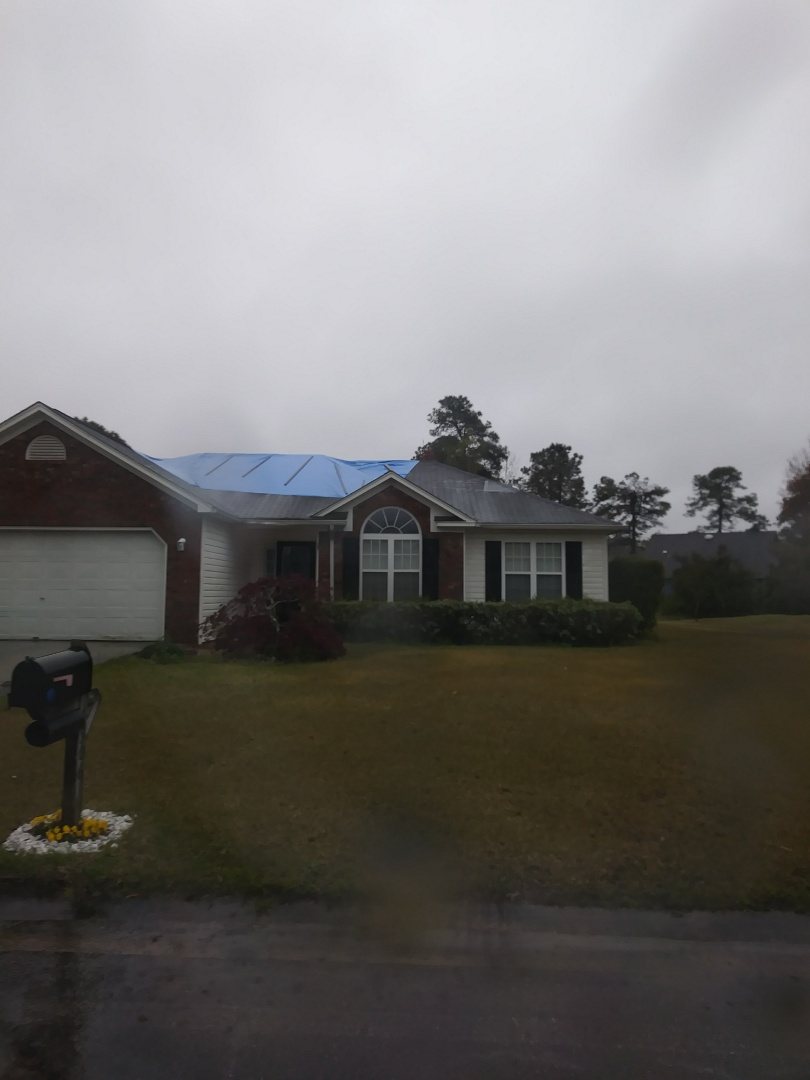 Free roof estimate to replace hurricane damage with hurricane rated lifetime asphalt shingle.