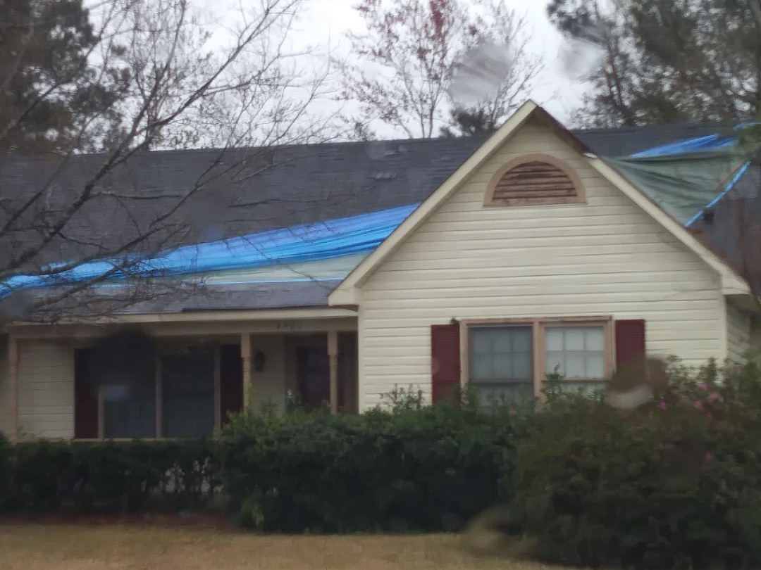 Lifetime metal roofing estimate to replace storm damage shingles. Financing available and free gutters special is a great bonus.