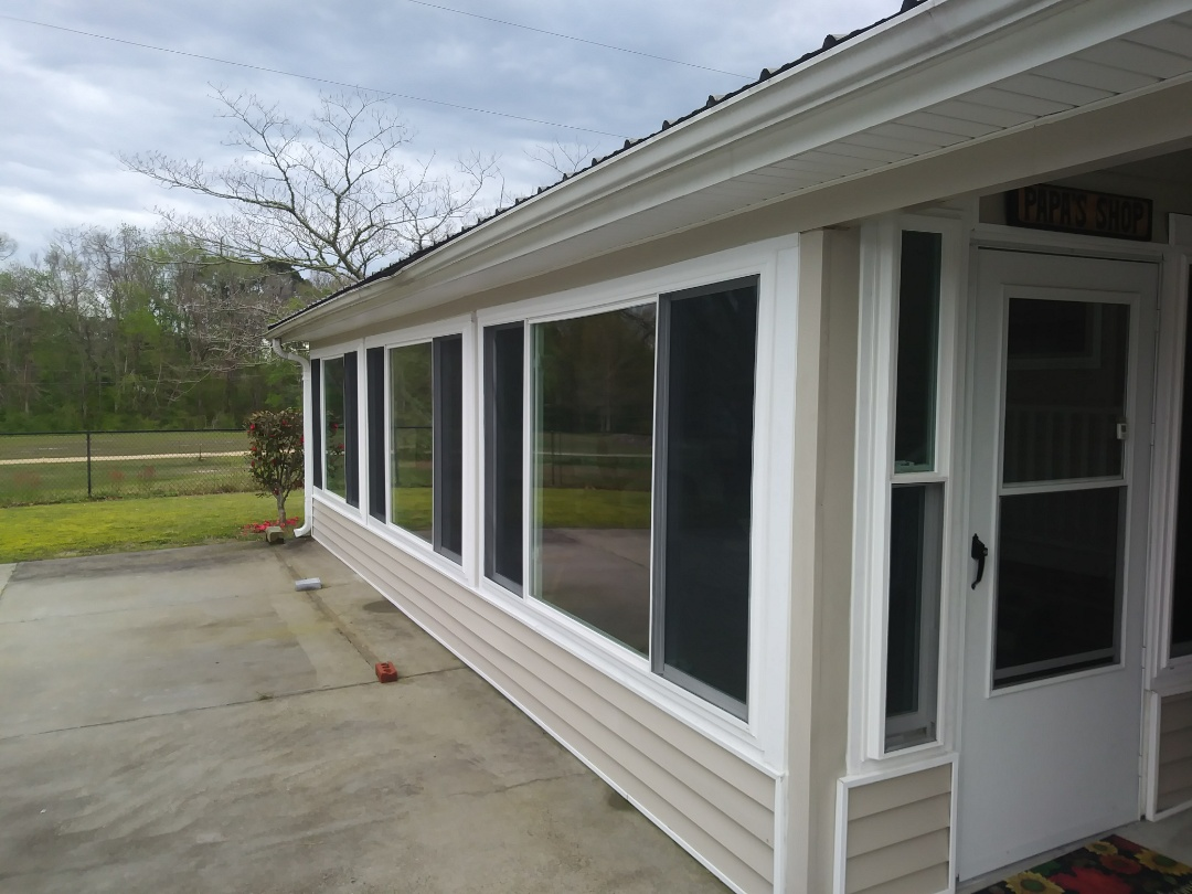 Porch conversion to 4 season sunroom 6, 2 lite sliders 2 double hung windows, entry door and storm door keep the pollen out and make this a great space to entertain in any season. Windows are energy efficient with Low E, argon and lifetime warranty.  Estimates are free