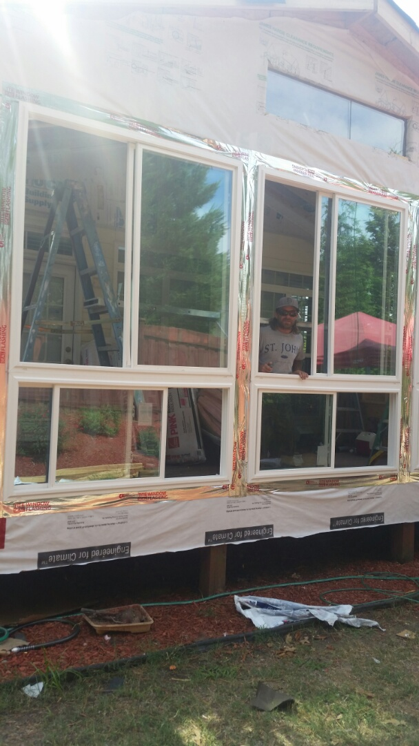 Morrisville, NC - Work continues on sunroom project. Windows and doors in broom framed with electrical rough-in.