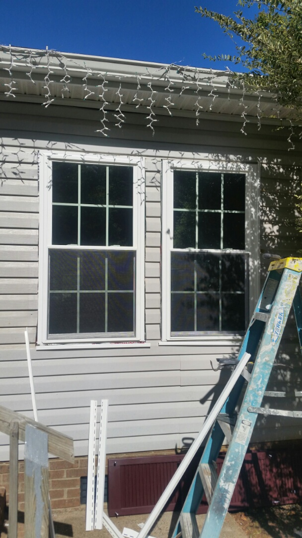 Clayton, NC - New windows being installed in a modular home. Remove 13 existing metal windows and installed 13 vinyl replacement windows. Removed vinyl siding and installed Windows with a new construction flange