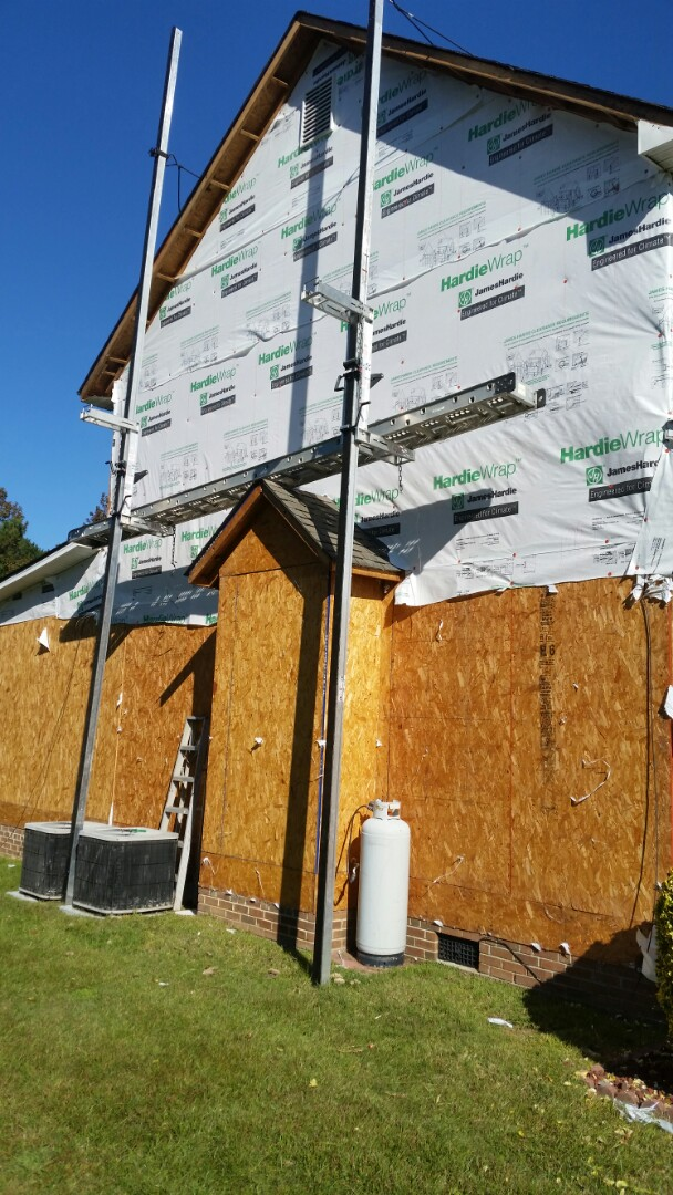 Pleasant Grove, NC - Progress continues on vinyl siding replacement project. Old siding being removed and house wrap being installed before new siding.