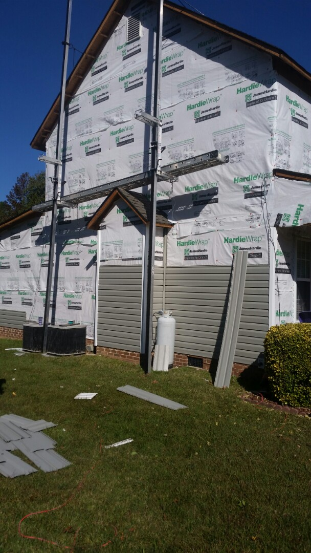 Willow Spring, NC - New vinyl siding being installed. All new soffitt and fascia will be wrapped in metal.