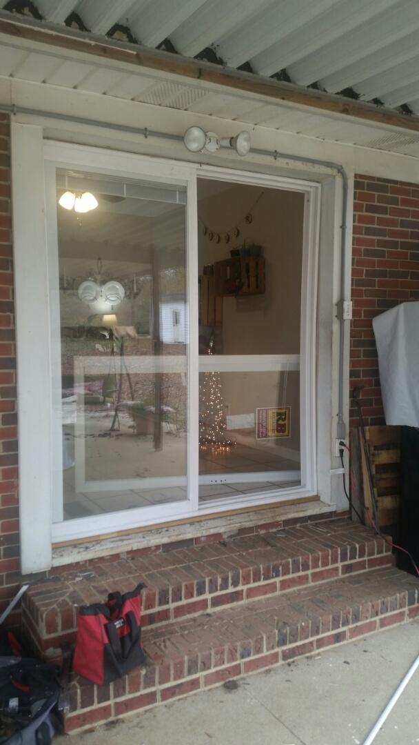 Garner, NC - Removed old metal sliding patio door and installed new vinyl sliding patio door