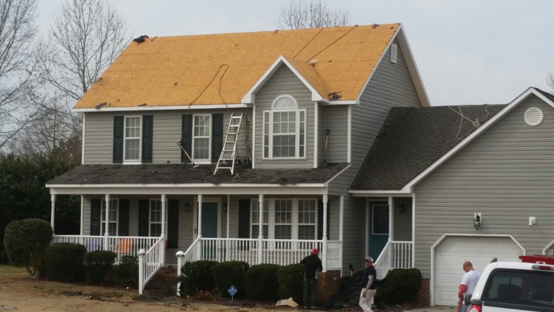 Pleasant Grove, NC - Repeat customer replaced vinyl siding previously. Now replacing shingle roof with new metal roof. Old shingles coming off.