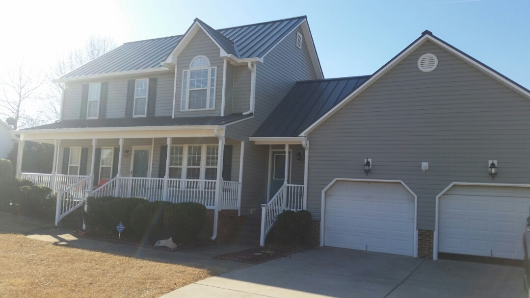 Pleasant Grove, NC - Finished up home renovation in Willow Springs. New vinyl siding new soffit and fascia new metal roof and new gutters. Customer States they have received many compliments from the neighborhood