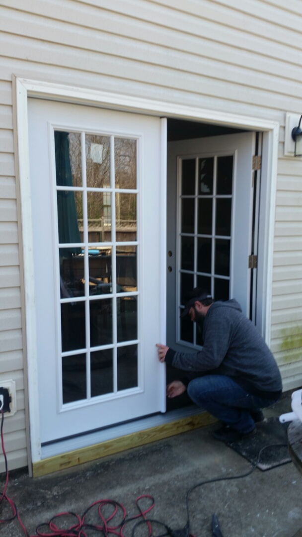Clayton, NC - Our installers working hard replacing an aging sliding patio door with a new double hinged French door