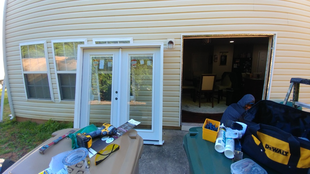 Clayton, NC - Removing existing steel French Door and replacing with a new Composite French Door.