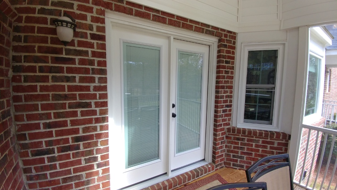 Clayton, NC - Removing an existing Patio Door and Installing a New Single Open French Door from Lowes Home Improvements.