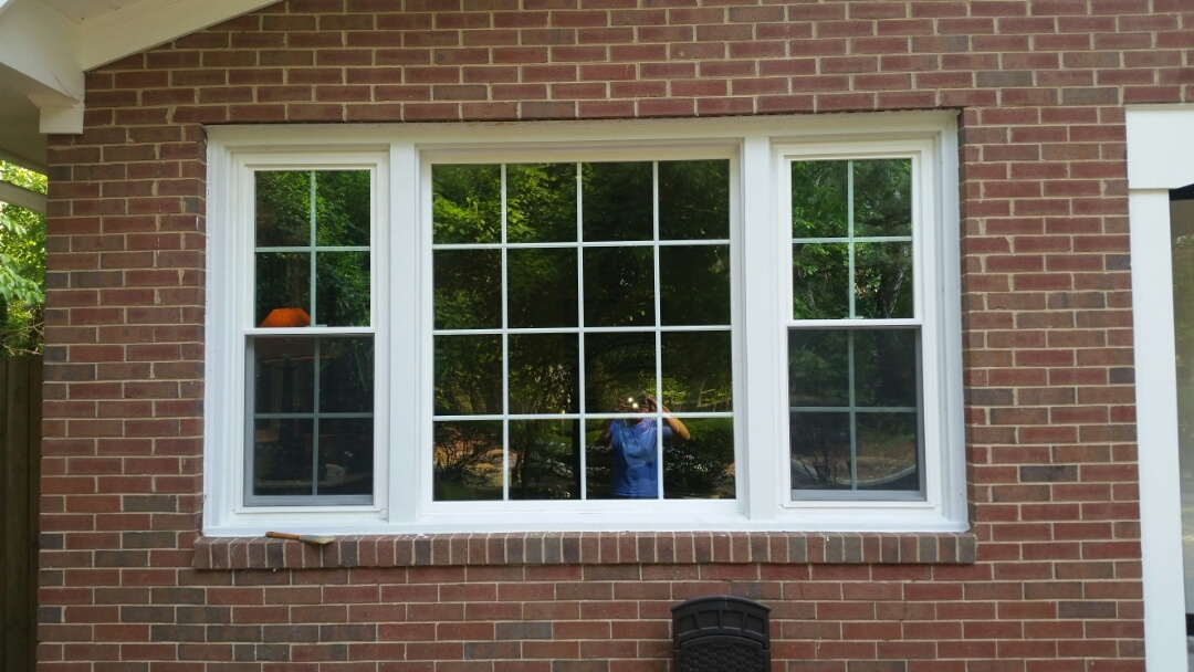 Chapel Hill, NC - Removed 2 wood double hings and a wood picture window and replace with 3 vinyl replacement windows.