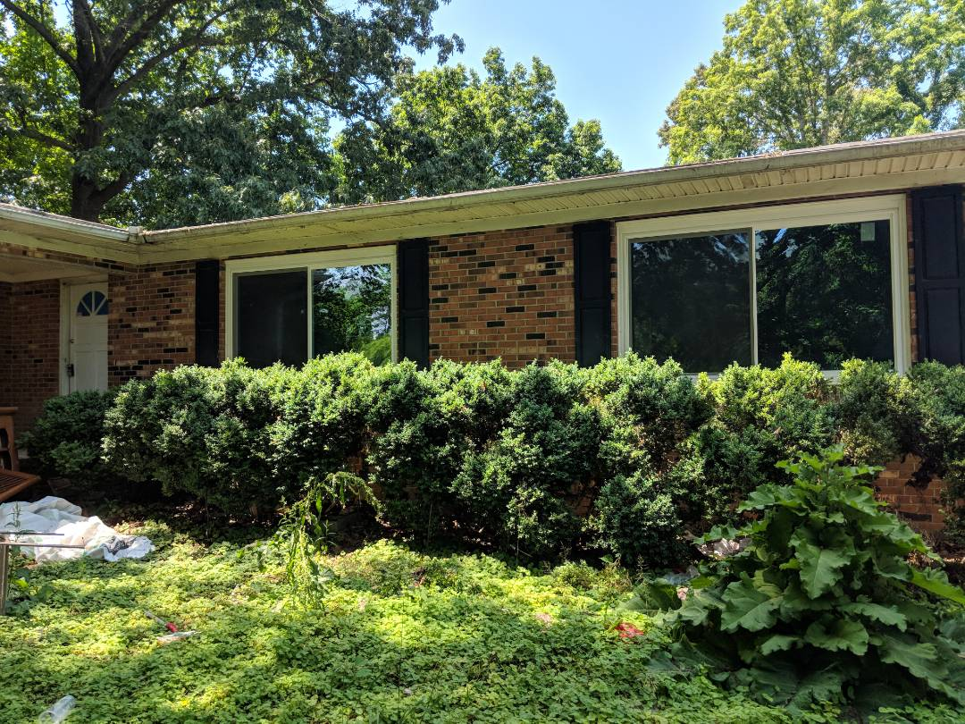 Durham, NC - Newly completed job in Durham. Repeat customer. Removed to aging wood bow windows and replace with two vinyl replacement energy-efficient 2 lite sliders