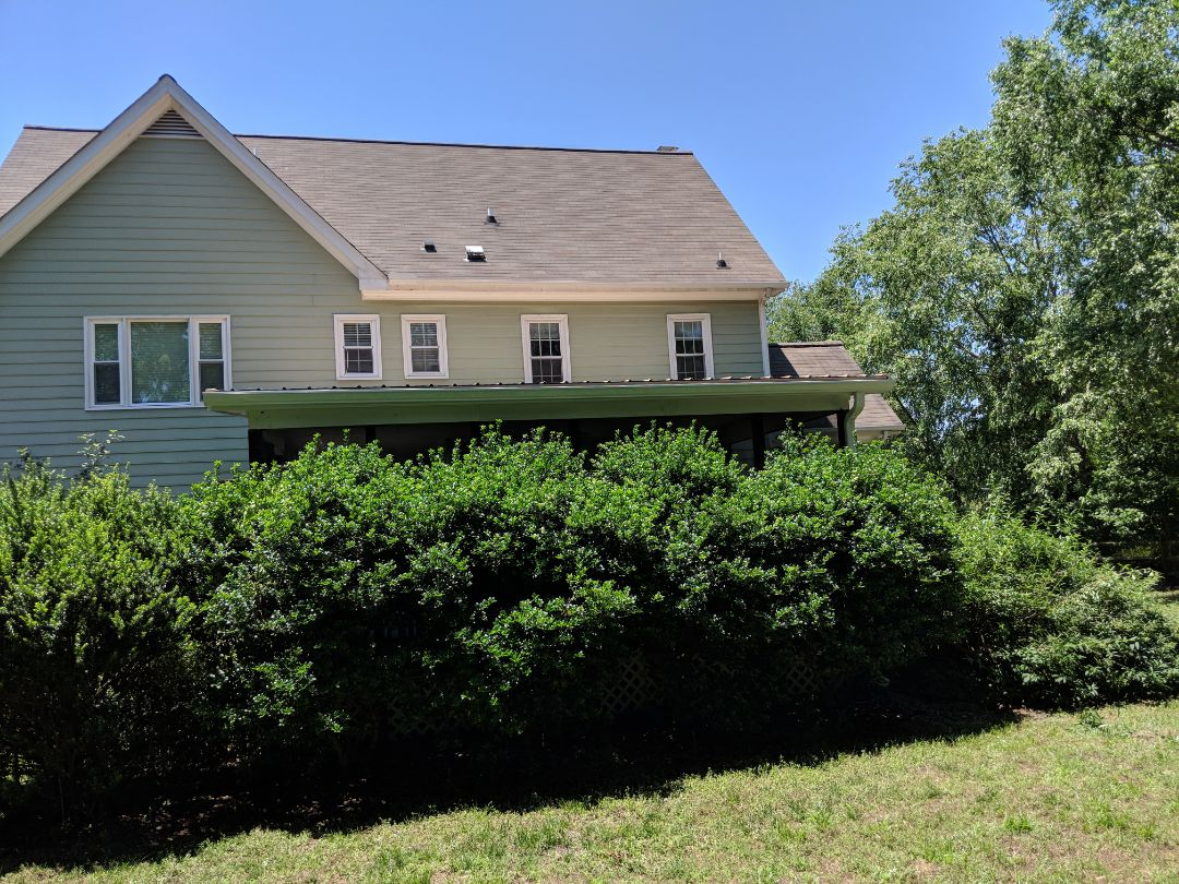 Fuquay Varina, NC - Previous customer in Fuquay Varina. Replace 3 aging Anderson wood windows with three energy-efficient vinyl replacement windows. Also installed new gutters on customers back porch. Energy catchers previously did a metal roof on an outbuilding and on the customers back porch.