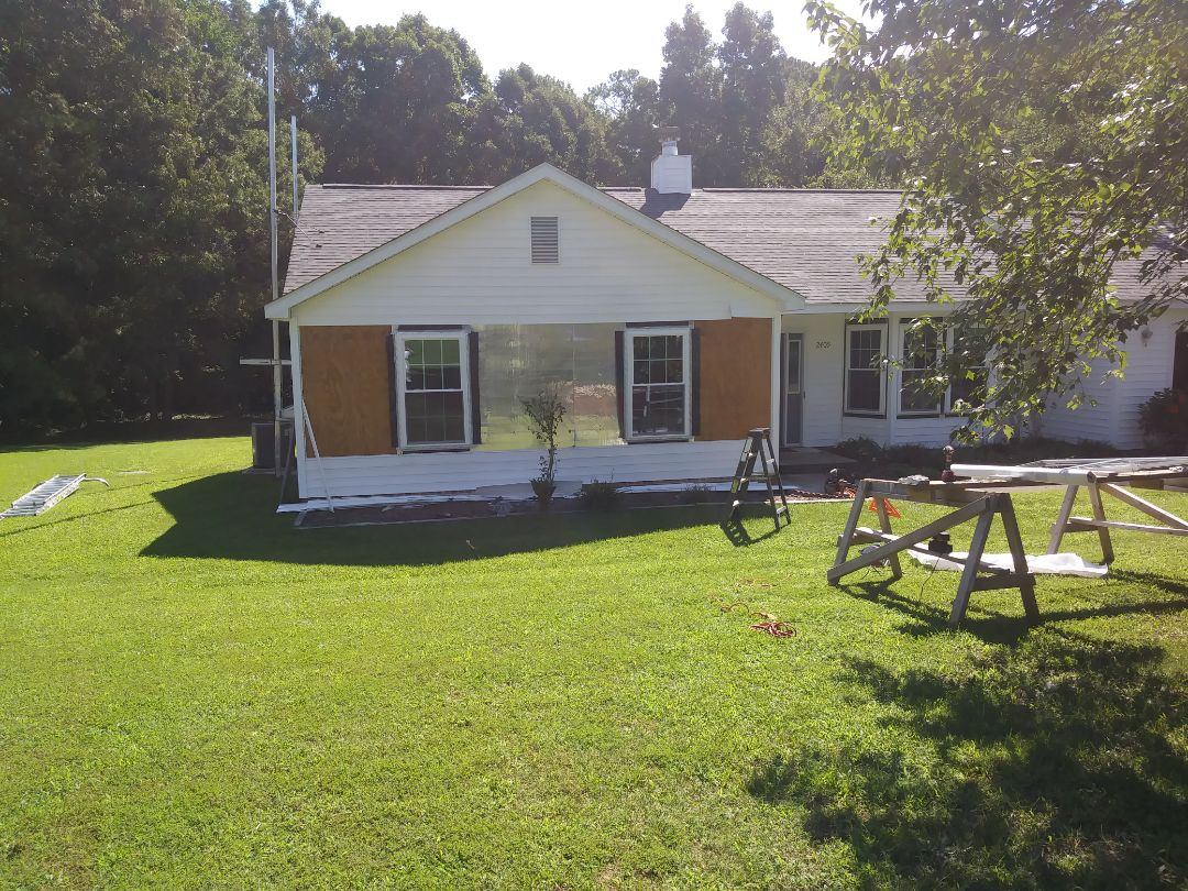 Fuquay Varina, NC - Day 2 of install in Fuquay Varina. Removing 11 vinyl windows and replacing with 11 energy-efficient vinyl replacement windows. Vinyl siding removal and replacement and also installing a patio sliding door and an entry door