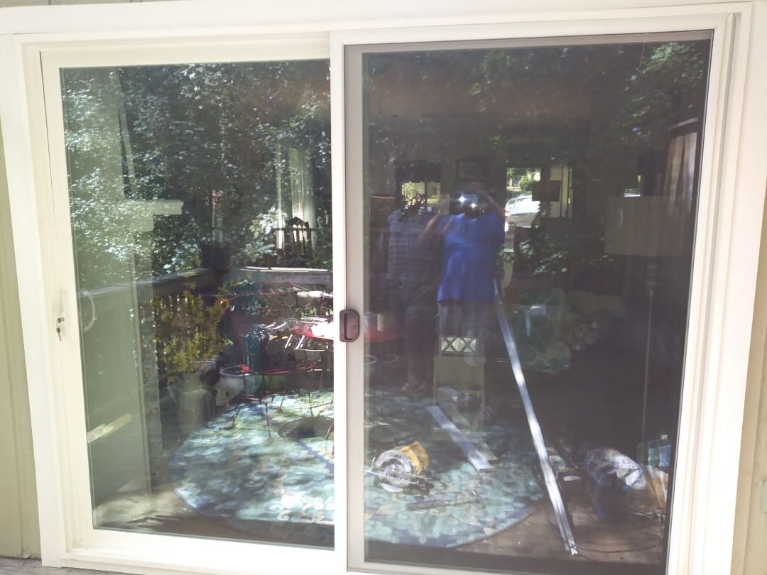 Raleigh, NC - Removed aging metal sliding patio door and installed an 8' vinyl sliding patio door. Low e, tempered glass.
