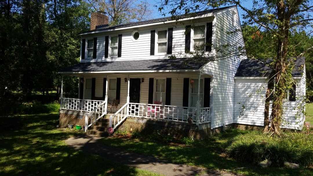 Knightdale, NC - Replacing old wooden windows with new vinyl and search wrapping the windows