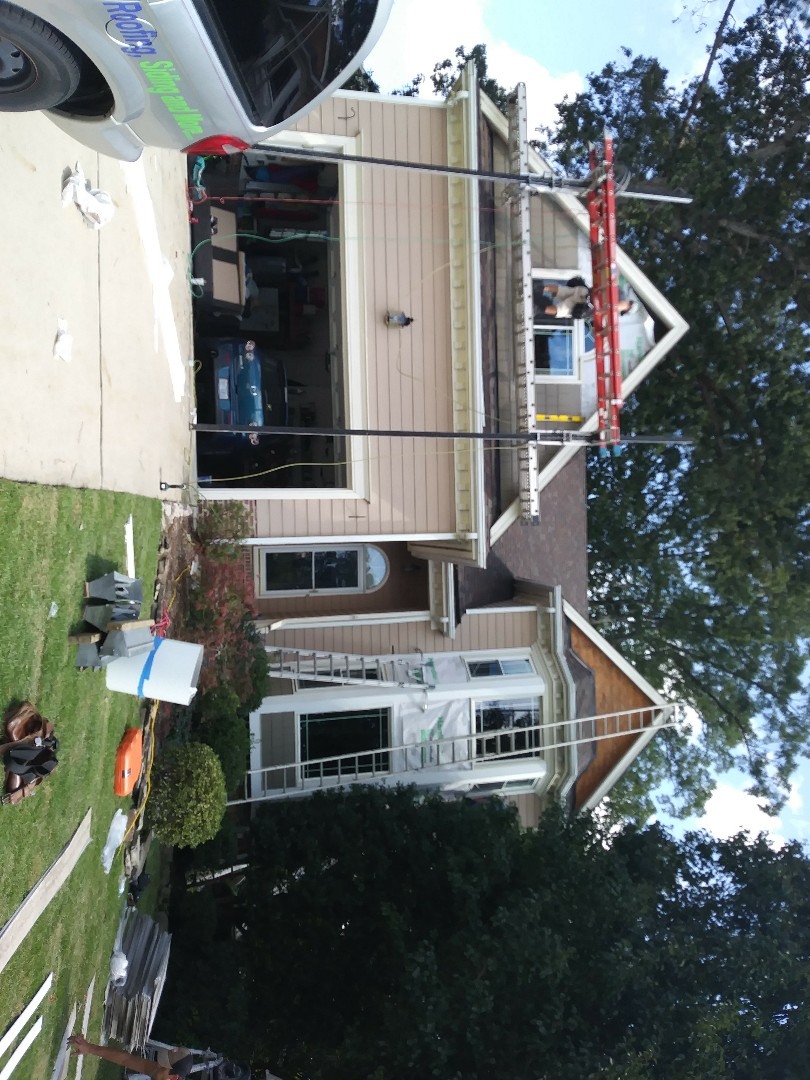 Apex, NC - Installing new Hardie color plus Cedar Shake siding on the front of this house and replacing the wood windows with vinyl windows