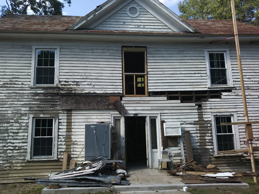 Current project in Franklinton. Century-old home getting refurbished. Installed 18 energy-efficient vinyl replacement windows