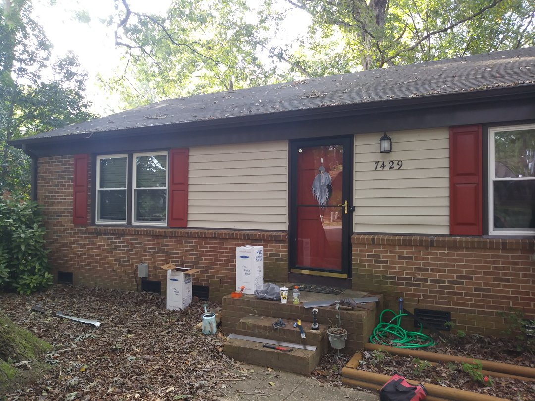 Finishing up previous job in Raleigh. Remove 10 Wood Anderson Windows and replace with 10 energy-efficient vinyl replacement windows. Back today too remove and rewrap windows with dark brown aluminum