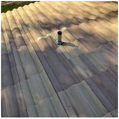 Riverside, CA - Re-felt for tile roof using 30lb Fontana felt paper and existing Boral tiles.