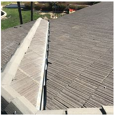 Redlands, CA - Valley repair using 30 lb Fontana felt paper using existing Boral tiles