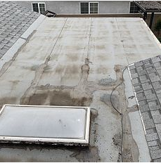 Highland, CA - Customer called in with leak issues. After further review, our technician found that there was water pooling on the flat roof and recommended it be redone.