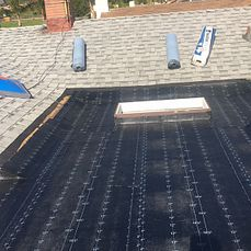 Highland, CA - Our men removed the existing cap sheet and skylight and installed 2 layers of Owens Corning Deck Seal SA Ply Base and Owens Corning  Deck Seal SBS Cap Sheet Granulated in white.