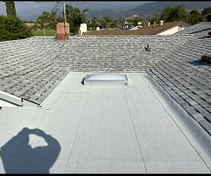 Highland, CA - These are the final results with the Owens corning Deck Seal SBS Cap Sheet Granulated and the new double donmed skylight in color white.