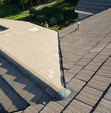 Riverside, CA - This is the finished result of the valley repair using existing Boral tiles and valley metal.