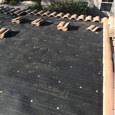 Riverside, CA - For the partial re-felt, our men removed the tiles and set them aside and applied 30lb Fontana Felt paper.