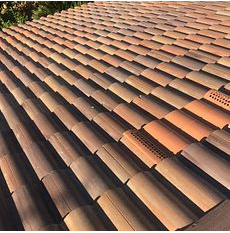 Rialto, CA - This is the final result of the re-felt including O'Hagin Galvanized Steel Low Profile Tapered Vent and the existing Boral tiles.