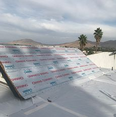 Riverside, CA - Our men removed 1 layer of rock roofing, 1 layer of cap sheet and 1 layer of wood shake. They installed 1 layer of 30lb Fontana Felt Paper and Atlas FR-10.
