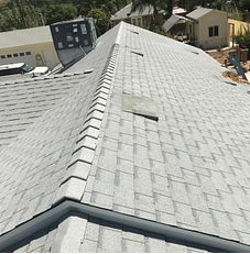 Moreno Valley, CA - This is the final result of the new roof using Owens Corning Tru Def Duration Sure Nail Shingle Roof System in the color Shasta White and Owens Corning Low Profile Slant Back Vents.