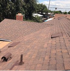 Rialto, CA - Note how the Owens Corning Low Profile Slant Back Vents were painted to match the roof. Our men take special care in making sure that the roof is aesthetically pleasing, durable and weather tight. On this project we used the Owens Corning Tru Definition Duration Sure Nail Shingle Roof System in the color Forest Brown.