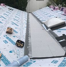 Loma Linda, CA - In order to make sure the roof will last its entire life span, we make sure to use the best  material. Our men installed Owens Corning Low slope (3) ply system, which includes Deck Seal Nailable Base, Deck Seal SA Ply Base, and Deck Seal SBS Cap Sheet Granulated, in the cricket area. On the rest of the roof, our men installed Owens Corning Titanium UDL30 and Owens Corning Weather Lock - Ice and Water Shield in crucial areas.
