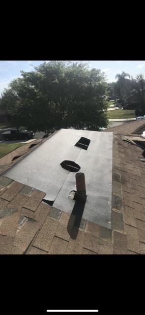 Riverside, CA - Removed one square of composition shingles to install one layer of 30 lb felt paper to install new Owens Corning Oakridge Shingles.