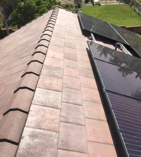Yorba Linda, CA - After installing the Boral Ply 40lb Underlayment we reinstalled existing tiles and replaced any broken ones. Lastly the solar panels were reinstalled with new Raised Stanchions.