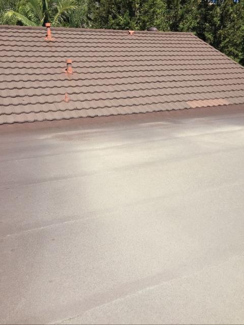 Orange, CA - This customer reached out to us to re-roof his flat roof garage. One layer of Cap sheet was being replaced with 60 Mil Carlisle/Versico TPO Membrane roof. We also needed to remove 3 courses of metal roofing to tie in the new roof system. We made sure to seal it under the wood shake and re install the metal roofing.