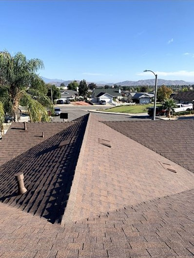 Moreno Valley, CA - We finally installed Owens Corning Tru def duration Cool Roofing Shingle Roof System in the Forrest Brown color with brown drip edge metal.