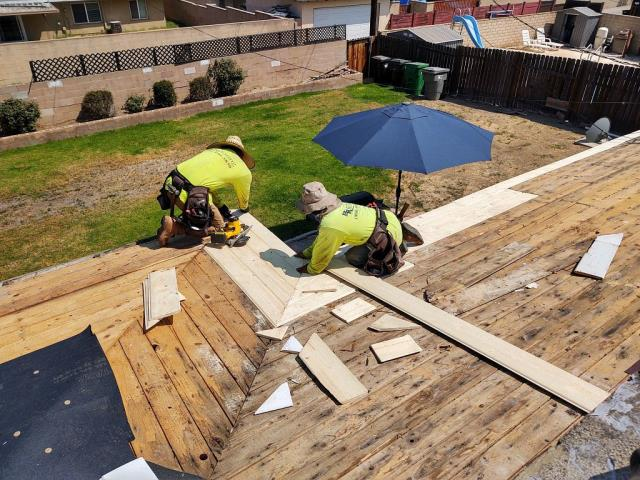 Corona, CA - After removing layers of composition roofing, we trimmed back starter board and shingles to be flushed to the existing fascia board.