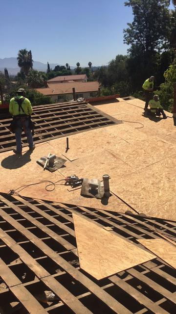 Redlands, CA - They ended up needing a roof replacement. So, we removed the existing concrete tile and started installing OSB Plywood over spaced sheathing.