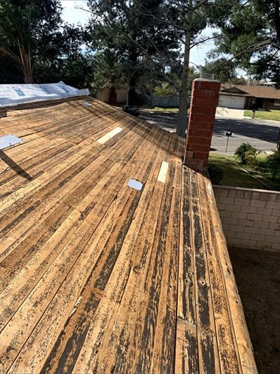 San Bernardino, CA - We started on the new roof by removing one layer of composition roofing then installing plastic needed in reroof.