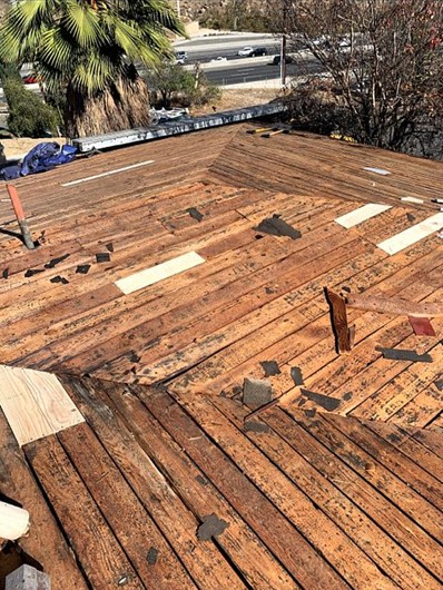 Riverside, CA - We trimmed back starter board to be flush to the existing fascia board. Afterwards we replaced, supplies, and installed one layer of Fontana Felt Paper.